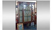 Edwardian Mahogany astral glazed cabinet with a