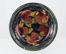 William Moorcroft Tube lined Shallow Bowl - Ochre Pomegranate Design. Date