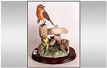 Border Fine Arts Bird Figure ' Robin and Chicks ' BO.345. Raised on an Oval