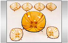 Amber Glass Fruit Set comprising serving bowl and 6 dishes.