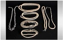 Assorted Costume Jewellery comprising 5 stands of Dynasty pearls.