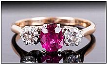 18ct Gold and Platinum Ruby and Diamond 3 Stone Ring, The Ruby of Excellent