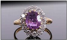 Ladies 18ct Gold Gallery Mounted Diamond and Amethyst Cluster Ring. The Cen