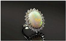 18ct White Gold Opal and Diamond Cluster Ring. The Large Opal Surrounded by