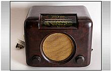 Vintage Brown Bakelite Radio by Bush with Central Speaker Grill with Rounde