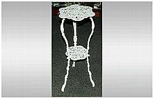 A Victorian Cast Iron 2 Tier Table. 28 Inches High x 14.5 Inches Wide.