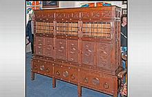 A Rare Aesthetic Movement Highly Carved Cabinet Cupboard In Oak. The top ha
