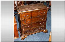Reproduction Mahogany Small Size Chest of Drawers with a carved block front