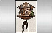 Black Forest Cuckoo Clock with weights and pendulum.