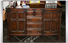 Traditional Stained Oak Dresser Base with 2 side cupboards and central ches