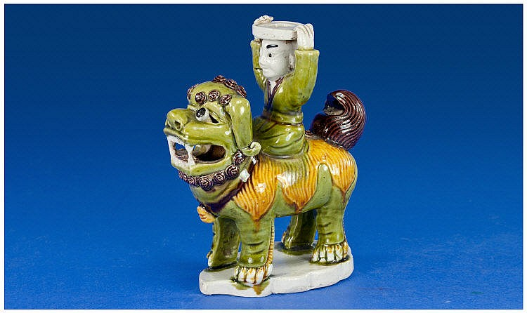 A Chinese Biscuit Porcelain Figure of a Lion Dog