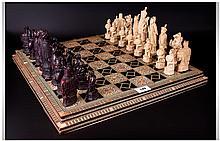 A Fine Quality Bone and Ebony Chessboard, Inlaid w