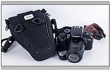 Canon EOS 700 film camera ;)  Camera with attached