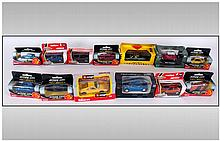 A Collection of 11 Boxed Die Cast Model Cars. Vari