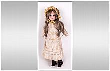 Armand Marseille Bisque Headed Doll with Brown Sle