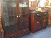 Two Modern Dark Wood Cabinets. Comprisin