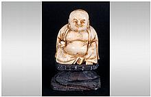 Chinese Late 19th Century Ivory Buddha Figure, Raised on a Black Lacquered