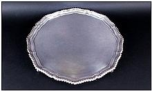 Elizabeth II Good Quality Very Large Circular And Shaped Silver Footed Salver, with gadroon border