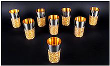 Stuart Devlin Fine Set Of Eight Silver & Silver Banded Beakers, each beaker with polished tapering c