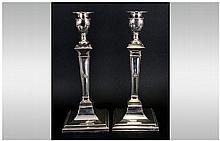 Pair Of Silver Plated Candle Sticks In The Adams Style, Raised Acanthus And Bead Decoration On Squar