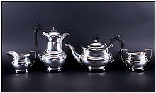 A Silver Four Piece Tea and Coffee Service. Consists of Tea Pot, Coffee Pot