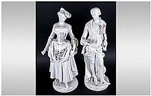 Pair Of German 19th Century Porcelain Figures of an elegant lady holding fl
