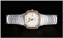 Longines - Day just Quartz - Gents Steel and Gold Wrist Watch. c.1980's. S. Num.20680560. Overall Co