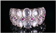 Rose Quartz and Ruby Ring, two rows of graduated, oval cut rose quartz cabo