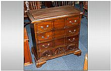 Reproduction Mahogany Small Size Chest of Drawers with a carved block front, Rhode Island Chippendal