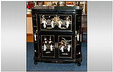 Black Lacquered Chinese Cocktail Cabinet onlaid with carved figures of Mother Of Pearl, depicting Ch