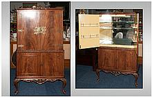 Mahogany Queen Anne Style Cocktail Cabinet with a cupboard top with fine engraved brass hinges and l