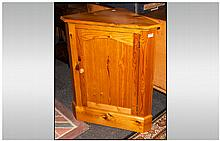 Free Standing Pine Corner Cupboard with Two Shaped Interior Shelves on a Plinth Base and Moulded Cor