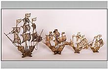 Four Gilded Metal Galleon Ship Ornaments, Probably Santa Maria. With enamel