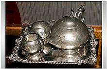 Three Piece Pewter Tea Set Planished Decoration. Unmarked. Together With A