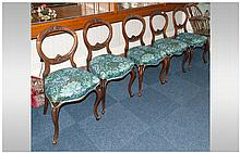A Set of Five Victorian Carved Walnut Balloon Back Chairs with carving to the top and central bar. O