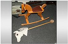 Rocking Horse comprising a  Horse on stick (Hobby Horse Type)