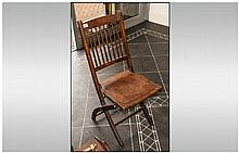An Austrian Bentwood Style Folding Bar Chair with slatted back and pressed seat.