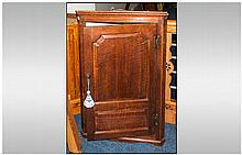 An Antique Georgian Single Door Corner Cupboard of Small Size with a Shaped Chamford Door Panel with