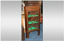 Edwardian Mahogany Inlaid Astral Glazed Standing Corner Cupboard of small size. Three interior shelv