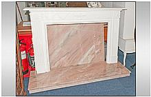 Georgian Style Fire Place with Cream Coloured Fire Surround and Marble Effect Base and Back.