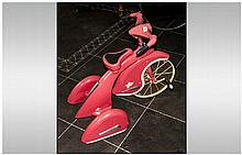A Replica Childs Pink Painted Tin Pedal Bike, in the 1930's design. Made by Airflow Collectables Inc