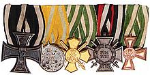 German medal bar, 5.9'' l., Iron Cross 1914 2nd class; Friedrich August Medal For Valor Saxony; Honor Cross, Saxony; Hindenburg Cross; Long Service Medal 15 years Saxony, good condition
