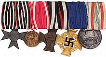 German medal bar, 6.2'' l., Prussian Military Cross for War Aid; Hessen Kriegsehrenzeichen; Hindenburg Cross WWI non-combatant; 40 Year Civil Service; WWI Service in Hungary Medal, good condition