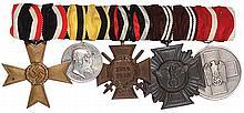 German medal bar, 6.5'' l., War Merit Cross 1939; Württemberg Medal for Military Merit WWI; Hindenburg Cross; NSDAP 10 Year Service; Social Welfare Medal, good condition