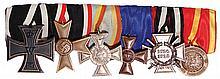 German medal bar, 7.5'' l., Iron Cross 1914 2nd class; War Merit Cross 1939 2nd class; Mecklenburg-Strelitz Bravery Merit Cross, 2nd class; Prussian 15 Year Military Service; Hindenburg Cross; Finnish Bravery Medal 1918, 2nd class, good condition