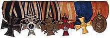 German medal bar, 9.0'' l., Iron Cross 1914 2nd class; Bavarian Cross of Military Merit 2rd class; Hindenburg Cross; Hanseatic Cross, Hamburg; Prussian 15 Year Military Service;  Prinz Regent Luitpold Medal 1905 Bavaria, bronze, good condition