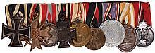German medal bar, 8.5'' l., Iron Cross 1914 2nd class; War Merit Cross 1939, 2nd class; Hessen General Honor Decoration; Hindenburg Cross; Austria WWI Service Medal; Czech Occupation Medal; Luftshultz Civil Defence medal 2nd class; Westwall Medal;