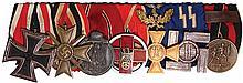 German medal bar, 8.4'' l., Iron Cross 1939 2nd class; War Merit Cross 1939, 2nd class; German East Medal WWII; German Red Cross Honor Award 1937 - 1939; Long Service Luftwaffe 40 Year; Long Service SS 12 Year; Sudetenland Annexation Medal, good