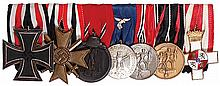 German medal bar, 7.3'' l., Iron Cross 1939 2nd class; War Merit Cross 1939 2nd class; German East Medal WWII; Luftwaffe 4 Year Long Service, Eagle on Ribbon; Austrian Anschluss Medal; Sudetenland Annexation Medal; Spain, Order of Military Merit,