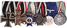 German medal bar, 7.1'' l., Iron Cross 1914 2nd class; War Merit Cross 1939 2nd class; Bavarian Order of Military Merit, 4th class, Silver 900; Hindenburg Cross; Army 4 Year Long Service, Eagle on Ribbon; WWI Service in Hungary Medal, good condition